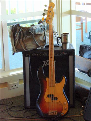 Ol' Thumper, an amp, a gig bag, and the all-important cup of coffee