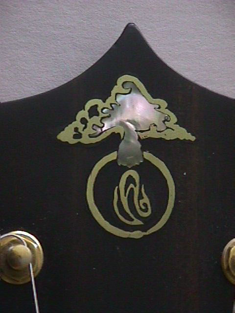 brass and shell logo
