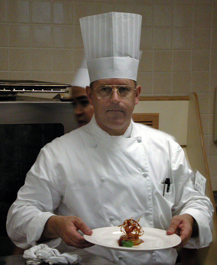 "Al at the Culinary Institute of America with flan and hard caramel ""doodads"""
